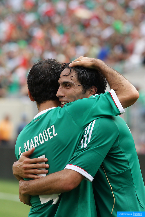Aldo De Nigris, Mexico, (right) celebrates after scoring with team mate Rafael Marquez during the Mexico V Wales international football friendly match at MetLife Stadium, East Rutherford, New Jersey, 23rd May 2012. Photo Tim Clayton