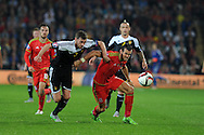 Gareth Bale of Wales breaks away from Belgium's Nicolas Lombaerts.  Wales v Belgium, UEFA Euro 2016 qualifying match at the Cardiff city Stadium in Cardiff, South Wales on Friday 12th June 2015. pic by Andrew Orchard, Andrew Orchard sports photography.
