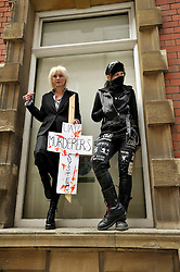 © Licensed to London News Pictures. 02/04/2012.  Performance artist and human rights activist Milly Fish (left) protests against unmanned aerial vehicles or drones used for military operations in Afghanistan and elsewhere and for surveillance in the UK.  The protest was outside a conference on UAVs at Armada House in Telephone Avenue in central Bristol.  Police made several arrests...Photo credit : Simon Chapman/LNP