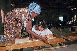 Kenyan Woman & Miriam Building Solar Oven