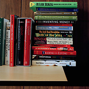Mini Library  photographed in the office of a investment manager, in London on the eighth of February 2007 shortly before the global recession. From the series Desk Job, a project which explores globalisation through office life around the World.