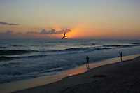 Tern and Two Fisherman at Sunrise.  Playalinda Beach, Canaveral National Seashore in Florida. Image taken with a Nikon 1 V2 camera and 18.5 mm f/1.8 lens (ISO 200, 18.5 mm, f/4, 1/1000).