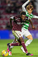Beni Baningime (#6) of Heart of Midlothian FC holds off Kyogo Furuhashi (#8) of Celtic FC during the Cinch SPFL Premiership match between Heart of Midlothian FC and Celtic FC at Tynecastle Park, Edinburgh, Scotland on 31 July 2021.