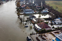 © Licensed to London News Pictures. 04/02/2021. Laleham, UK. Rising floodwater continues to surround residential riverside properties in Laleham Reach, Surrey where the River Thames has burst it's banks. Large parts of the UK have experienced more wet conditions bringing further flooding . Photo credit: Peter Macdiarmid/LNP
