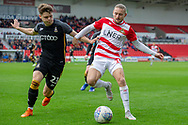 Doncaster Rovers forward Alfie May battles with Bradford city defender Connor Wood during the EFL Sky Bet League 1 match between Doncaster Rovers and Bradford City at the Keepmoat Stadium, Doncaster, England on 22 September 2018.
