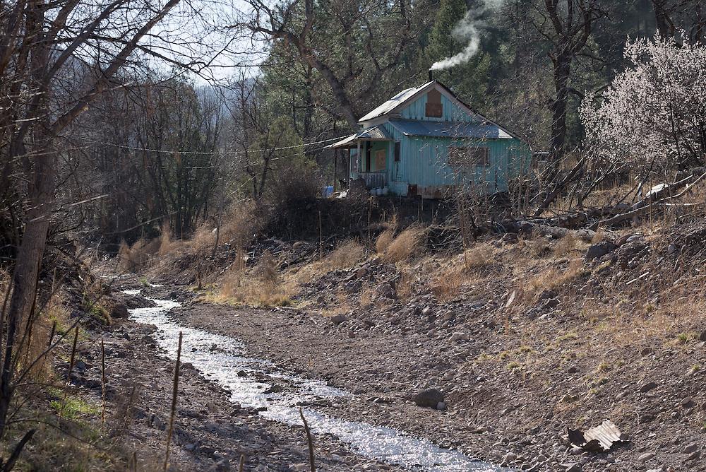 House along Silver Creek in Mogollon, New Mexico.