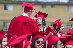 May 23, 2019 - Anaheim, California, U.S. - Happy graduates congratulate each other during the commencement ceremony for the Savanna High School Class of 2019 at Handel Stadium at Western High School in Anaheim on Thursday, May 23, 2019. (Credit Image: © Mark Rightmire/SCNG via ZUMA Wire)