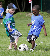Middletown, New York - Children play soccer during a program at the Middletown YMCA on May 28, 2011.