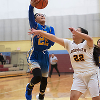 Zuni's Kari Kallestewa (22) drives to the basket for a layup  as Rehoboth Christian's Patricia Chavira (22) defends Friday night at Rehoboth Christian School in Rehoboth.