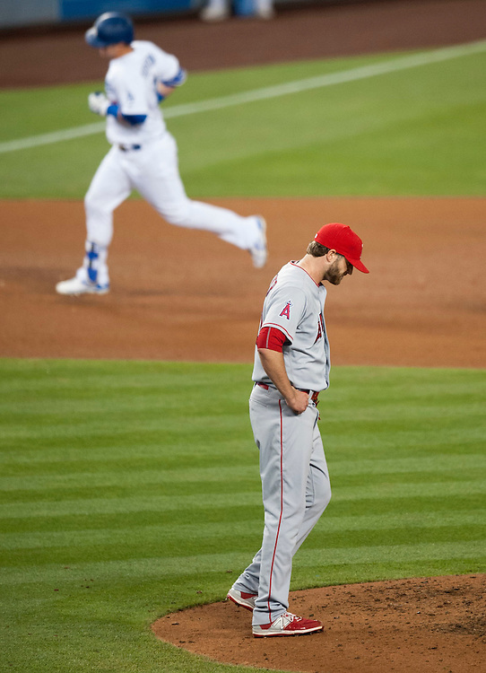The Dodgers' Joc Pederson rounds the bases after his second home run of the game, this one off of Angels' reliever A.J. Achter in the eighth inning during the Angels' 5-1 loss Tuesday night at Dodger Stadium.<br /> <br /> / //ADDITIONAL INFO:   <br /> <br /> angels.0518.kjs  ---  Photo by KEVIN SULLIVAN / Orange County Register  -- 5/17/16<br /> <br /> The Los Angeles Angels take on the Los Angeles Dodgers in inter-league play at Dodger Stadium Tuesday night.