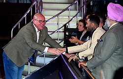 Nick Leeson shakes hands with Jermaine Pennant after he leaves the house after finishing in fourth place during the live final of Celebrity Big Brother at Elstree Studios, Hertfordshire.