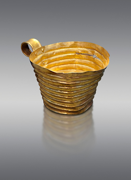 Mycenaean gold cup with horizontal grroves, Grave IV, Grave Circle A, Mycenae, Greece. National Archaeological Museum of Athens.  Grey Background<br /> <br /> <br /> An elegant precious gold cup hammered from thick gold to created a simple elegant design. This Mycenaean gold cup demonstrates how advance Mycenaean metalworking was in the 16th century BC. The value of the cup would have been extermely high so must have graced the table of a Mycenaean noble perhaps even a v king. .<br /> <br /> If you prefer to buy from our ALAMY PHOTO LIBRARY  Collection visit : https://www.alamy.com/portfolio/paul-williams-funkystock/mycenaean-art-artefacts.html . Type -   Athens    - into the LOWER SEARCH WITHIN GALLERY box. Refine search by adding background colour, place, museum etc<br /> <br /> Visit our MYCENAEN ART PHOTO COLLECTIONS for more photos to download  as wall art prints https://funkystock.photoshelter.com/gallery-collection/Pictures-Images-of-Ancient-Mycenaean-Art-Artefacts-Archaeology-Sites/C0000xRC5WLQcbhQ