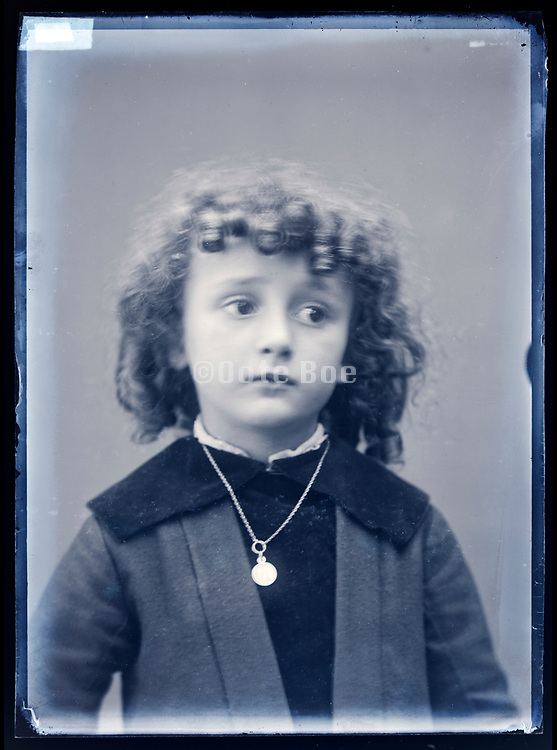 portrait of a girlie looking young boy with curly hair France circa 1920s