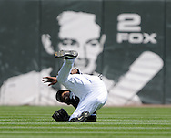 CHICAGO - AUGUST 20:  DeWayne Wise #31 of the Chicago White Sox makes a diving catch during the game against the Seattle Mariners at U.S. Cellular Field in Chicago, Illinois on August 20, 2008.  The White Sox defeated the Mariners 15-3. (Photo by Ron Vesely)
