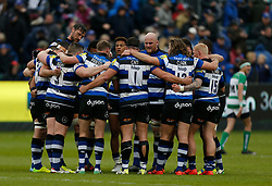 Bath hold a team talk on the pitch at half time during the Aviva Premiership match at the Recreation Ground, Bath.