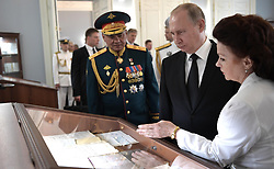 July 30, 2017 - Saint Petersburg, Russia - July 30, 2017. - Russia, Saint Petersburg. - Russian President Vladimir Putin visits the Main Admiralty historical building in St. Petersburg on Russian Navy Day. Left: Defense Minister, Army General Sergey Shoigu. (Credit Image: © Russian Look via ZUMA Wire)