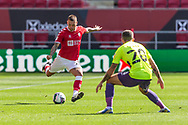 Bristol City's Jack Hunt (2) launches a kick past Exeter City's Lewis Page (20) during the EFL Cup match between Bristol City and Exeter City at Ashton Gate, Bristol, England on 5 September 2020.
