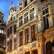 Guildhalls in the Grand Place, Brussels. Originally the city's central market place, the Grand-Place is now a UNESCO World Heritage site. Ornate buildings line the square, including guildhalls, the Brussels Town Hall, and the Breadhouse, and seven cobbelstone streets feed into it.