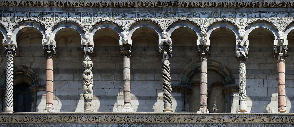 Panorama of the Arcades of St Michele of the 13th century Romanesque facade of the San Michele in Foro,  a Roman Catholic basilica church in Lucca, Tunscany, Italy .<br /> <br /> Visit our ITALY PHOTO COLLECTION for more   photos of Italy to download or buy as prints https://funkystock.photoshelter.com/gallery-collection/2b-Pictures-Images-of-Italy-Photos-of-Italian-Historic-Landmark-Sites/C0000qxA2zGFjd_k<br /> <br /> If you prefer to buy from our ALAMY PHOTO LIBRARY  Collection visit : https://www.alamy.com/portfolio/paul-williams-funkystock/lucca.html .<br /> <br /> Visit our MEDIEVAL PHOTO COLLECTIONS for more   photos  to download or buy as prints https://funkystock.photoshelter.com/gallery-collection/Medieval-Middle-Ages-Historic-Places-Arcaeological-Sites-Pictures-Images-of/C0000B5ZA54_WD0s