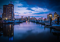 Baltimore City skyline at twilight from marina by Jeffrey Sauers of Commercial Photographics, Architectural Photo Artistry in Washington DC, Virginia to Florida and PA to New England