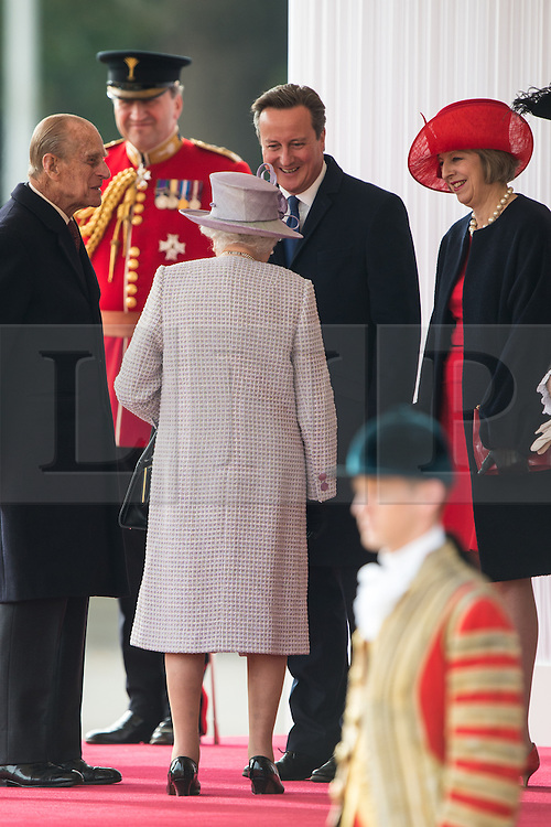 © London News Pictures 20/10/2015. Prime Minister David Cameron, Teresa May joined HM The Queen, HRH The Duke of Edinburgh.<br /> <br /> More than 1,100 soldiers and 230 horses joined HM The Queen, HRH The Duke of Edinburgh, The Duke and Duchess of Cornwall, the Prime Minister, Senior members of the Cabinet, the Lord Mayor of London, the Mayor of London, and the Defence Chiefs of Staff for the ceremonial welcome to Britain of The President of The People's Republic of China and Madame Peng Liyuan . Photo credit: Rupert Frere/LNP