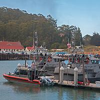 Coast Guard boats dock in San Francisco Bay at a marina at Cavallo Point, near Sausalito, California.