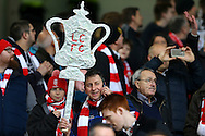 Lincoln City fans hold up their silver cardboard FA Cup trophy. The Emirates FA cup 5th round match, Burnley v Lincoln City at Turf Moor in Burnley, Lancs on Saturday 18th February 2017.<br /> pic by Chris Stading, Andrew Orchard Sports Photography.