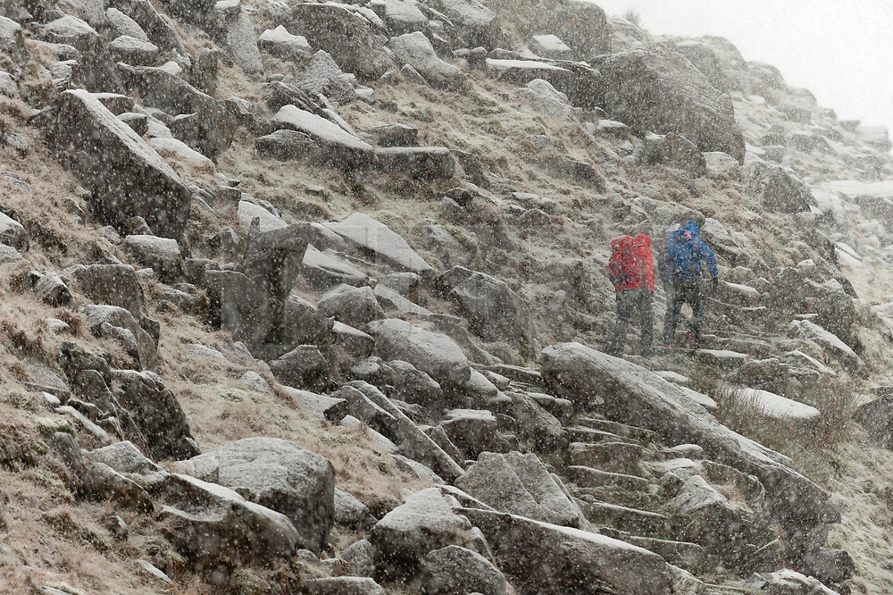 © Licensed to London News Pictures. 29/01/2019. Snowdonia, Gwynedd, Wales, UK. Climber and hikers set off in heavy snow for the summit of Snowdon as heavy snow hits Snowdonia National Park, Gwynedd, Wales, UK. credit: Graham M. Lawrence/LNP