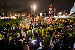 © Licensed to London News Pictures. 03/12/2019. London, UK. Pro and Anti Trump protesters meet outside Buckingham Palace during President Donald Trumps visit to the United Kingdom. Photo credit: George Cracknell Wright/LNP
