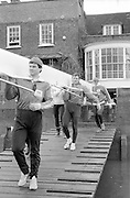 Chiswick. London.<br /> Nation Squard crew,  starting from Mortlake<br /> Crew, carring the boat out of the boathouse. ARA Headquarters W6.<br /> 1987 Head of the River Race over the reversed Championship Course Mortlake to Putney on the River Thames. Saturday 28.03.1987. John MAXEY, Martin CROSS and Steven REDGRAVE.<br /> <br /> [Mandatory Credit: Peter SPURRIER;Intersport images] 1987 Head of the River Race, London. UK