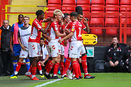 Charlton Athletic forward Lyle Taylor (9) celebrates with teammates after scoring the first goal of the match during the EFL Sky Bet League 1 match between Charlton Athletic and Shrewsbury Town at The Valley, London, England on 11 August 2018.