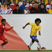 FOXBOROUGH, MASSACHUSETTS - JUNE 12:  Willian #19 of Brazil challenged by Miguel Trauco #6 of Peru  during the Brazil Vs Peru Group B match of the Copa America Centenario USA 2016 Tournament at Gillette Stadium on June 12, 2016 in Foxborough, Massachusetts. (Photo by Tim Clayton/Corbis via Getty Images)
