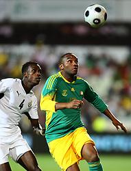Vodacom Park, Bloemfontein. Bafana vs Ghana.151008. Bafana striker Benni McCarthy  and Ghanaian defender John Boye keep their eyes on the ball. Picture: Etienne Rothbart.