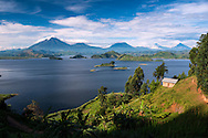 Lake Mutanda, Uganda, April 2014. Lake Mutanda lies in the shadow of the Virunga Mountain Range offering some of the most beautiful views on planet earth. Situated between Kisoro town, Mgahinga and Bwindi National Parks it makes a perfect base for gorilla trackers, volcano hikers, bird lovers as well as those looking for a secluded place in nature.  East of Lake Victoria, at the borders with Congo (DRC) and Rwanda, is where the East African savannah meets the West African jungle highlands and mountains. The route of our roadtrip becomes an epic journey over potholed mountain dirt roads, with a 4x4 vehicle, through some of Africa's most spectacular landscapes, various cultures, and National Parks. Photo by Frits Meyst / MeystPhoto.com