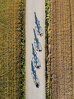 Aerial view of cyclists on sunny day in Sant Miquel de Cruilles, Spain