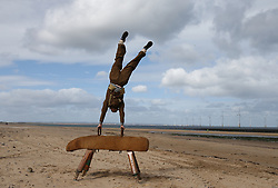 © Licensed to London News Pictures. 26/04/2016. Redcar, UK. An actor re-enacts a scene as part of the build up to the 2018 Festival of Thrift. 80 volunteers are helping artist and film-maker Richard DeDomenici to make a 'Redux' version of the five minute Dunkirk scene from the 2007 Oscar winning film Atonement on Redcar beach. The Festival of Thrift, 19th – 25th August 2018, is a week-long programme of temporary art installations in locations across the Tees Valley landscape. Photo credit: Nigel Roddis/LNP