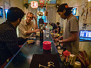 28 JANUARY 2016 - BANGKOK, THAILAND:  People in 23 Bar and Gallery in the Chinatown section of Bangkok.       PHOTO BY JACK KURTZ