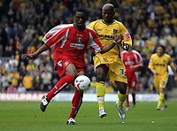 Photo: Rich Eaton.<br /> <br /> Oxford United v Leyton Orient. Coca Cola League 2. 06/05/2006.<br /> <br /> Orients Gabriel Zakuani and Oxfords Tchamp N'Toya go for the ball