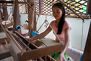 Silk factory producing grade-A silks near to Pradaet Pagoda in Angkor. Here just a few women weave using machines, the silks are sold locally in various outlets which show there is a good market for these traditionally made silks.