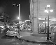 Y-590206-07. Night view of SW 3rd at Ash looking south. Multnomah Hotel. February 6, 1959.