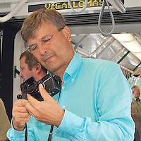 Budapest city mayor Gabor Demszky takes photos with his analogue photographer, Hasselblad camera on board the newly started Combino tram in Moszkva square, Budapest, Hungary. Saturday, 01. July 2006. ATTILA VOLGYI