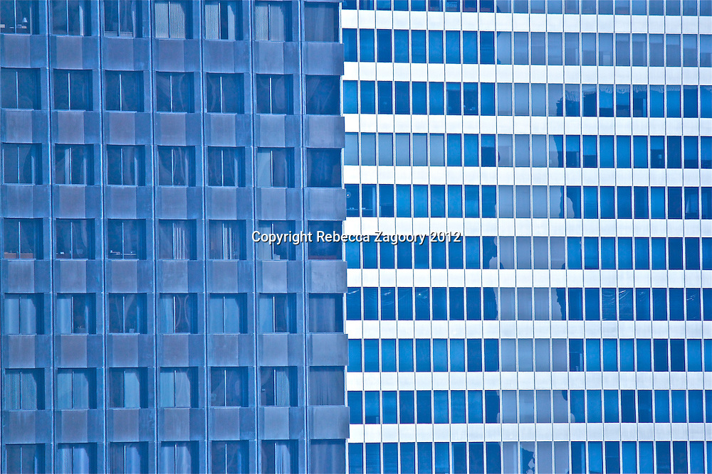 Square Versus Lines - A closer view of these two buildings gives the viewer a dizzying effect, as well as, sense of stories behind the curtains.