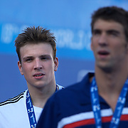 Michael Phelps, USA, leaves the podium followed by Gold medal winner  Paul Biedermann, Germany, after the Men's 200m Freestyle Final presentation at the World Swimming Championships in Rome on Tuesday, July 28, 2009. Photo Tim Clayton.