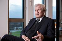 10 DEC 2016, BERLIN/GERMANY:<br /> Horst Seehofer, CSU, Bundesinnenminister, waehrend einem Interview, in seinem Buero, Bundesinnenministerium<br /> IMAGE: 20181210-02-014<br /> KEYWORDS; Büro, Kreuz