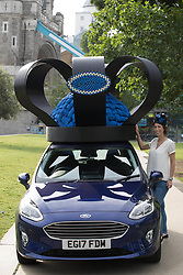 EDITORIAL USE ONLY A brand new 2017 Ford Fiesta Mk VII receives a regal makeover by royal milliner Rosie Olivia, to celebrate the car's track record as the UK's favourite at Tower Bridge in London.