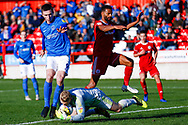 Portsmouth forward Oliver Hawkins (9) catches Accrington Stanley goalkeeper Connor Ripley (30) on loan from Middlesbrough,  during the EFL Sky Bet League 1 match between Accrington Stanley and Portsmouth at the Fraser Eagle Stadium, Accrington, England on 27 October 2018.