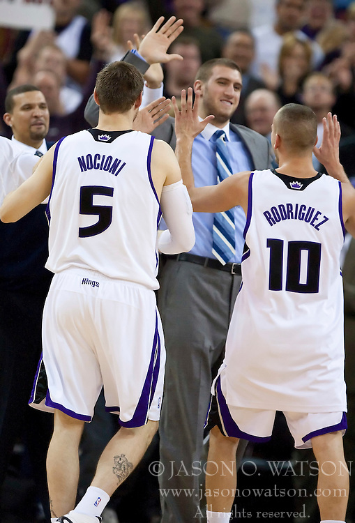 November 29, 2009; Sacramento, CA, USA;  Sacramento Kings center Spencer Hawes (center) celebrates with guard Sergio Rodriguez (10) and forward Andres Nocioni (5) during the fourth quarter against the New Orleans Hornets at the ARCO Arena.  Sacramento defeated New Orleans 112-96.