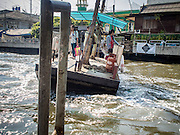19 JANUARY 2015 - BANGKOK, THAILAND: The ferry crosses to the Phetchaburi Road side of Khlong Saen Saeb. The small ferry crosses Khlong Saen Saeb throughout the day. It is powered by an diesel engine that uses a system of cables to pull the ferry the 30 feet across the canal. It's used by pedestrians  who need to get across the khlong. The nearest bridge is about ½ mile away.     PHOTO BY JACK KURTZ