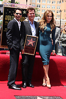 5/23/2011 Marc Anthony and Jennifer Lopez flank Simon Fuller during his Hollywood Walk of Fame ceremony