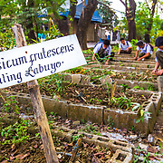 CAPTION: Parang High School students start working on a school garden, where they would like to grow their own vegetables. They recently attended a climate change workshop run by the local government and facilitated by ACCCRN's implementing partners, ICLEI. This helps to reinforce their knowledge of climate change impacts, mitigation and adaptation, and since attending the workshop they have been more active around their school, practicing mitigation and adaptation solutions and training other students in the same skills. LOCATION: Parang High School, Marikina City, Philippines. INDIVIDUAL(S) PHOTOGRAPHED: N/A.